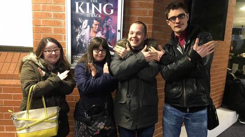 Hilly, Megan, Sam & Lewis doing making the X Factor sign.