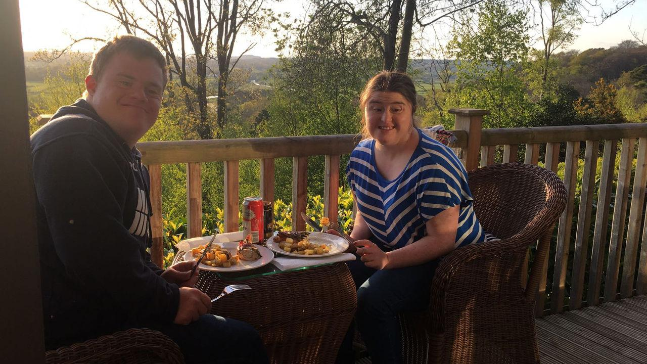 Hilly and Paul eating on the balcony at sunset