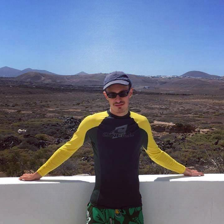 Lewis in Lanzarote with the hills behind him.