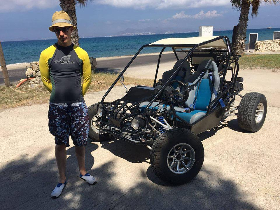 Lewis standing next to a beach buggy.