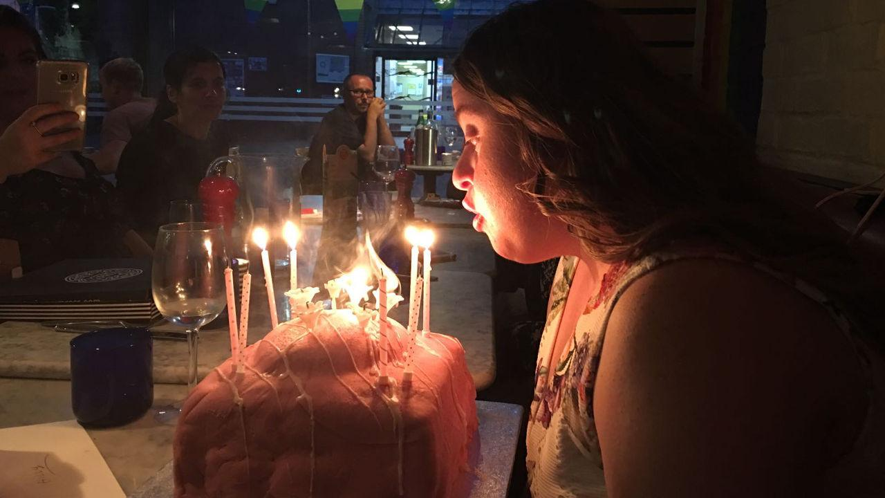 Hilly blowing out candles on her cake.