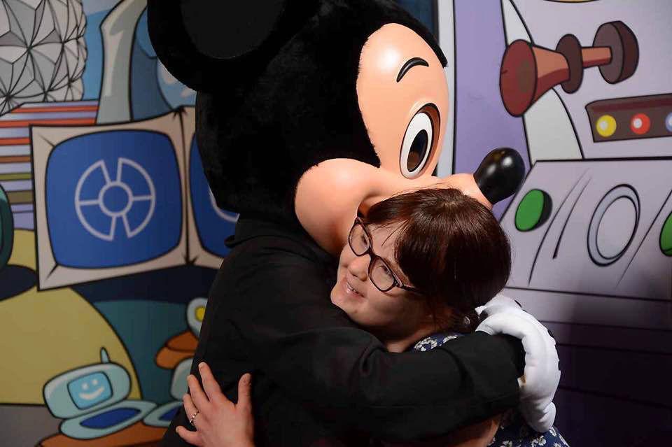 Megan hugging Mickey Mouse.