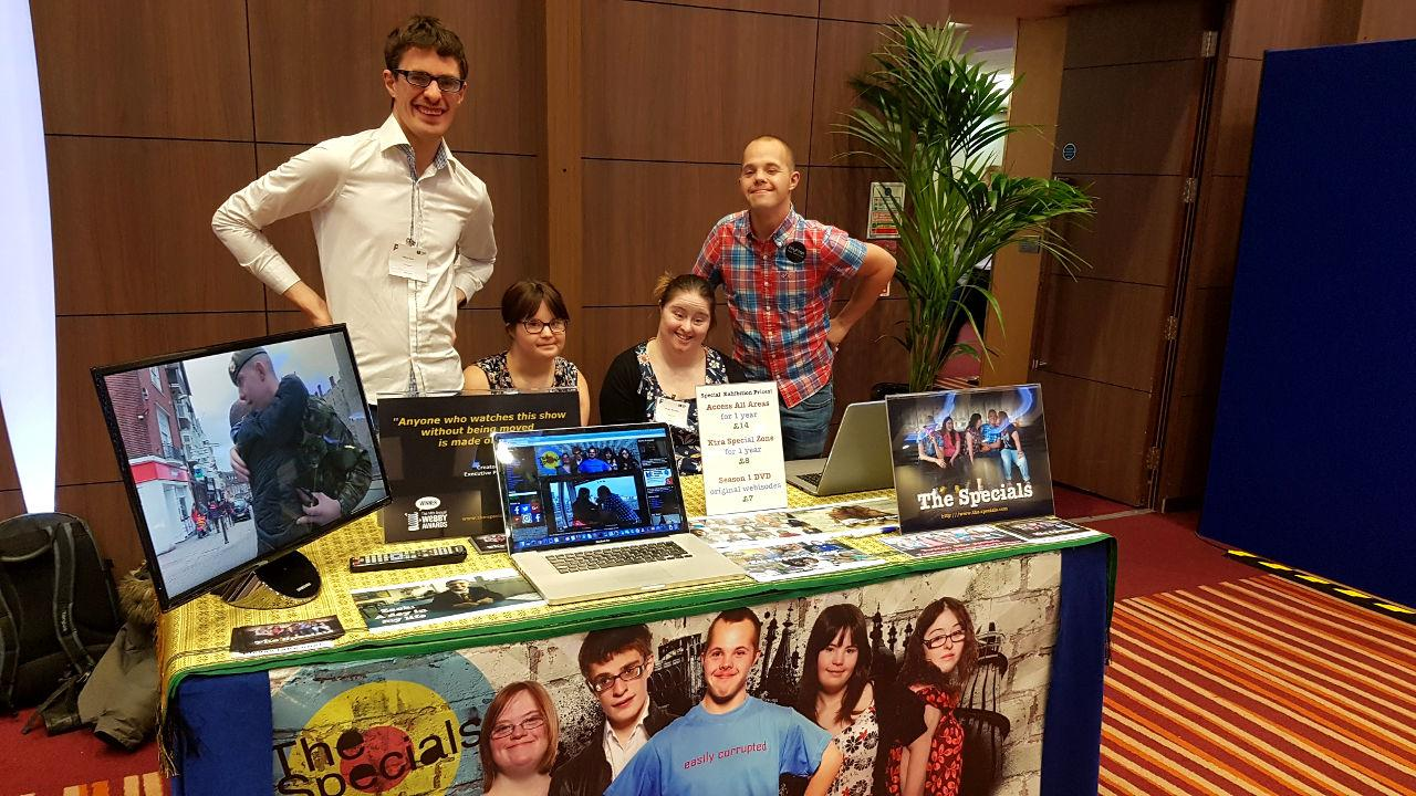 Lewis, Megan, Hilly & Sam at their stand at Learning Disability Today, 2017.