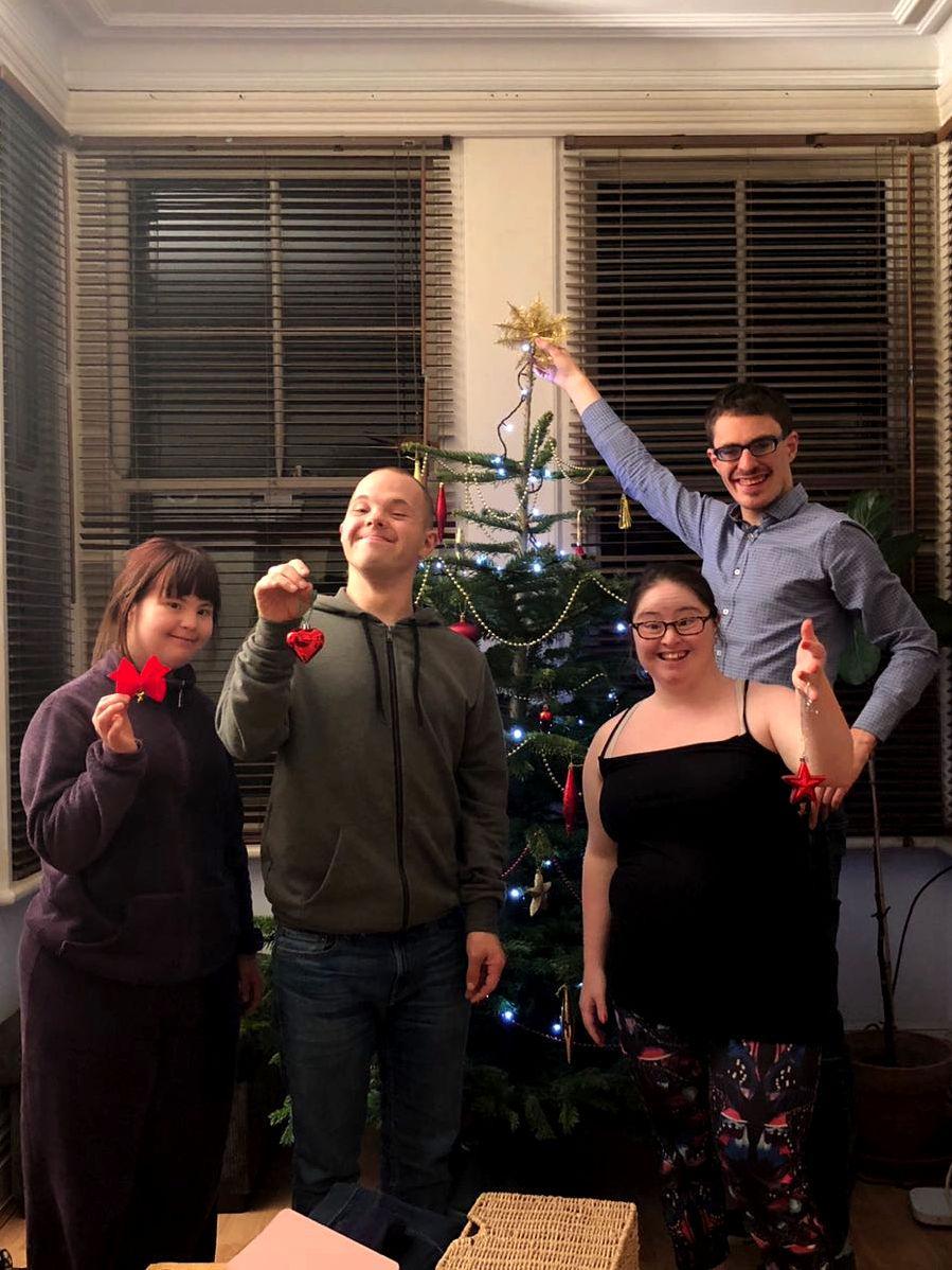 Megan, Sam, Hilly and Lewis decorating the Xmas tree.