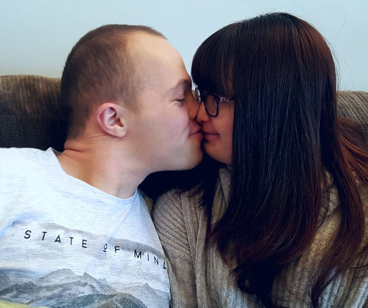 Sam and Megan kiss.