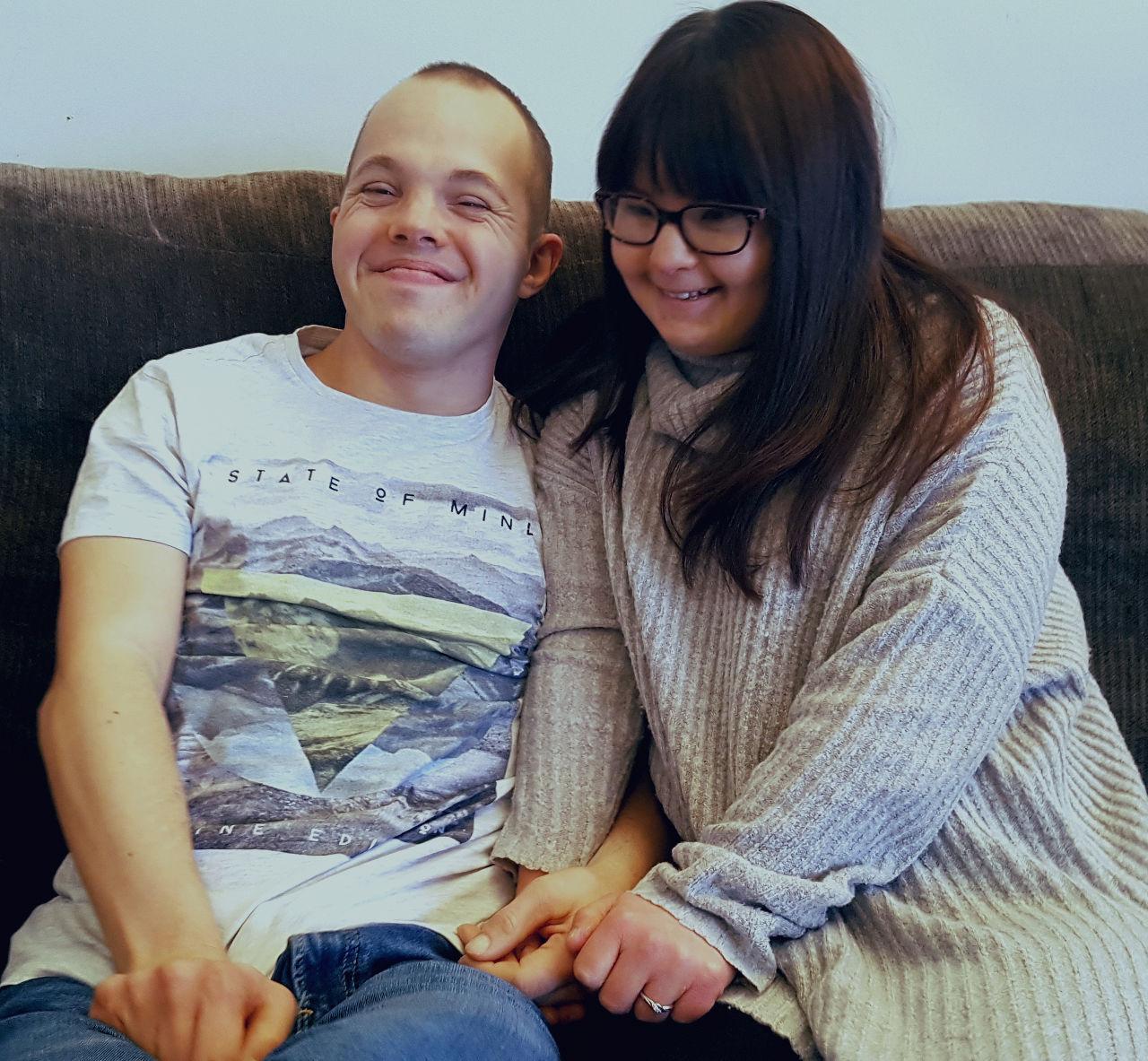 Sam and Megan smile.