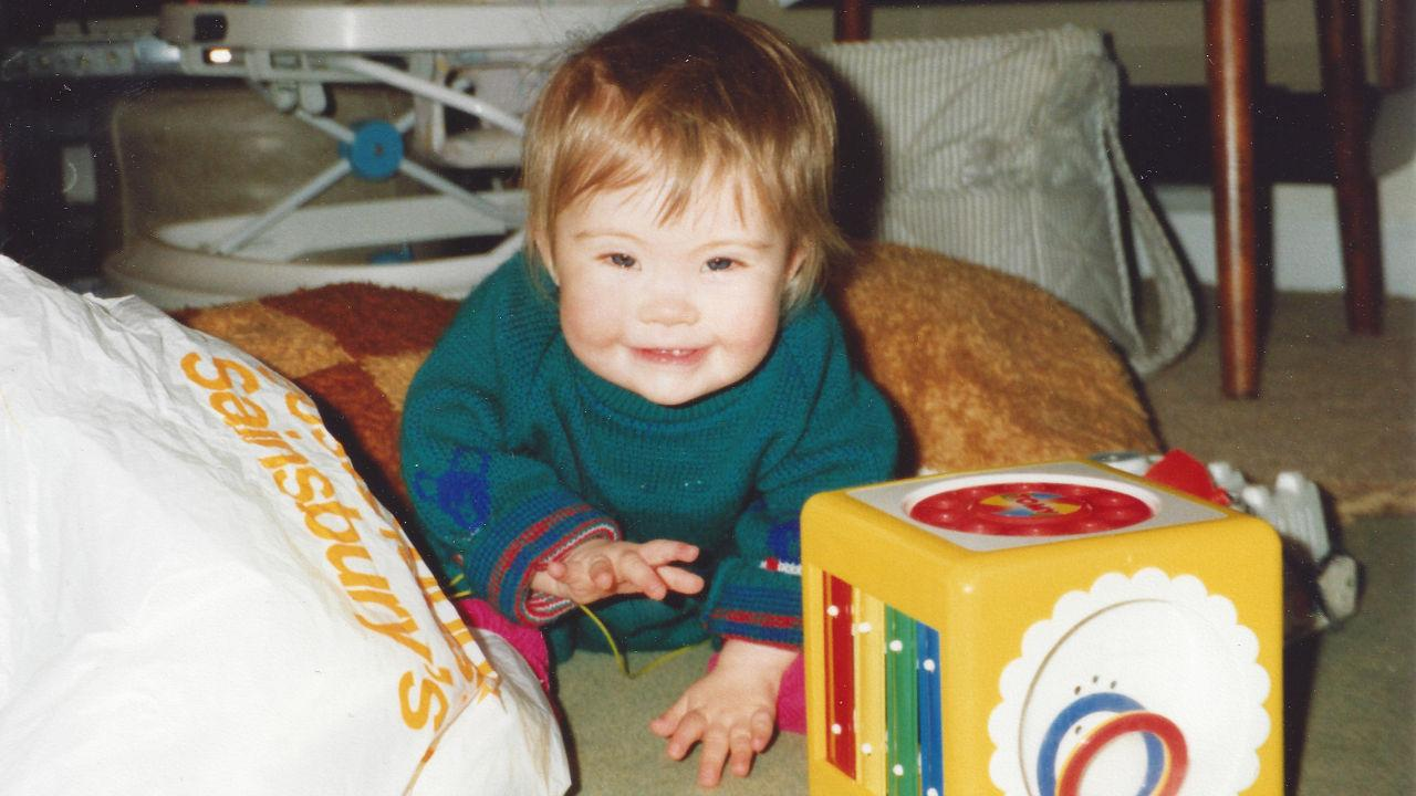 Megan crawling as a toddler.
