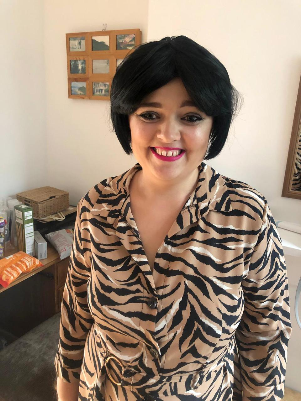 Debbie wearing a wig to look like her favourite soap character.