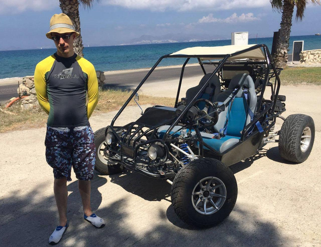Lewis in Kos next to a beach buggy.
