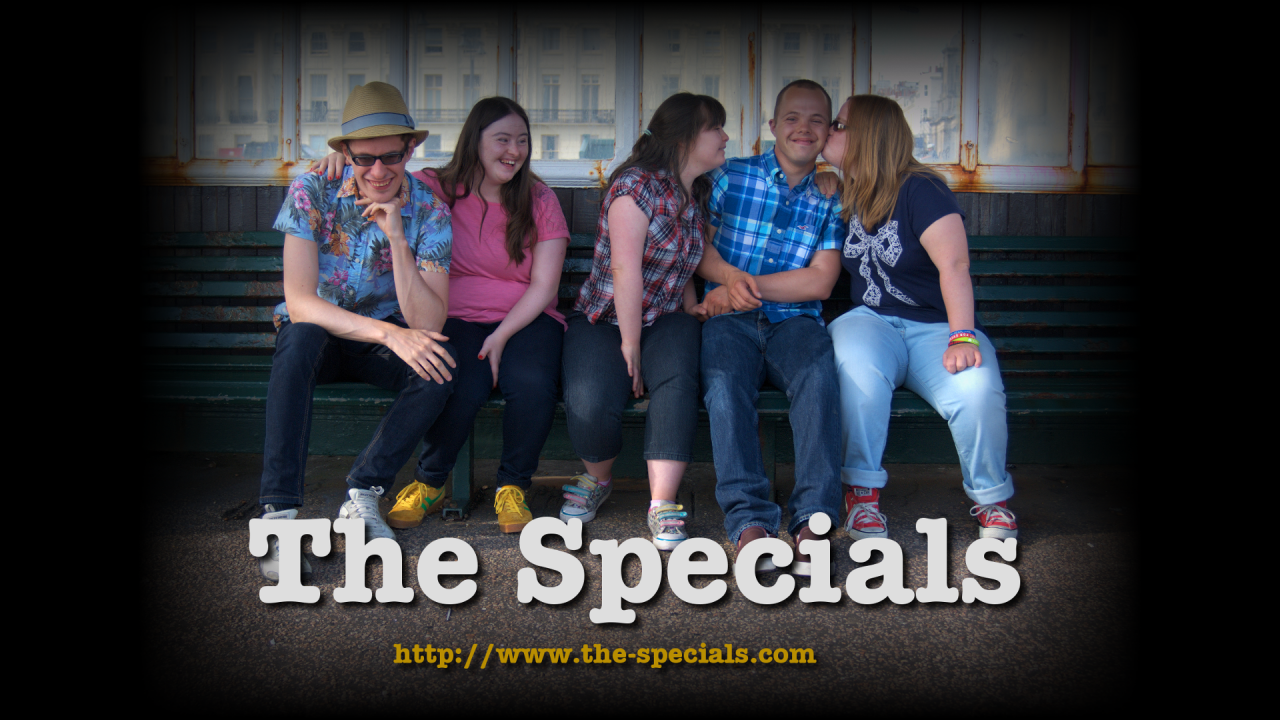 "Flyer image for Season 2 of ""The Specials"": Lewis, Hilly, Megan, Sam and Lucy on a bench on Brighton promanade. Lucy is kissing Sam on the cheek. Underneath is a big ""The Specials"" title and the URL of the website."