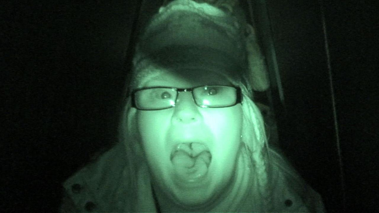 Lucy screaming at the camera in the dark.