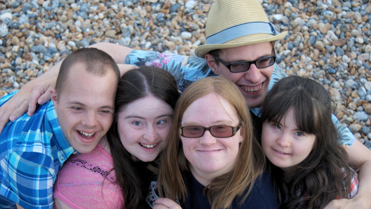 Sam, Hilly, Lucy, Lewis and Megan in a group hug on Brighton beach.
