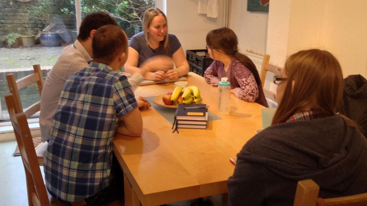 Sam, Lewis, Katy, Megan and Lucy discuss things around the kitchen table.