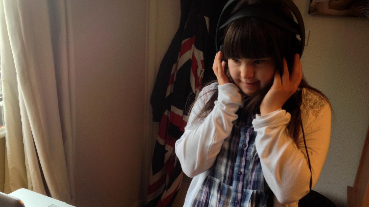 Megan listens to some of the voiceover she has just recorded.