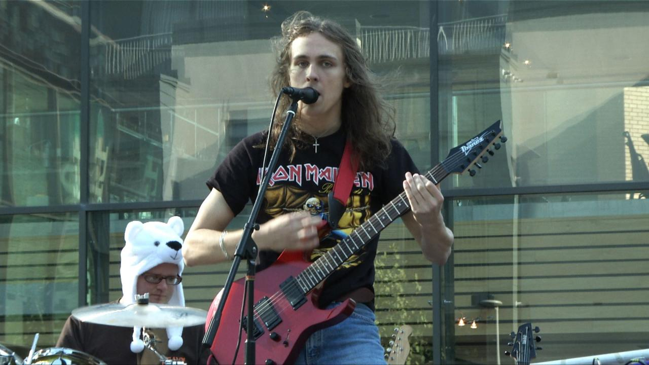 """Ryan, the """"Beat Express"""" guitarist rocking out on stage."""