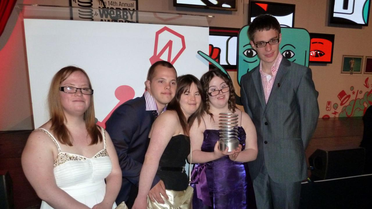 """The Specials"" with one of their Webby Award trophies."