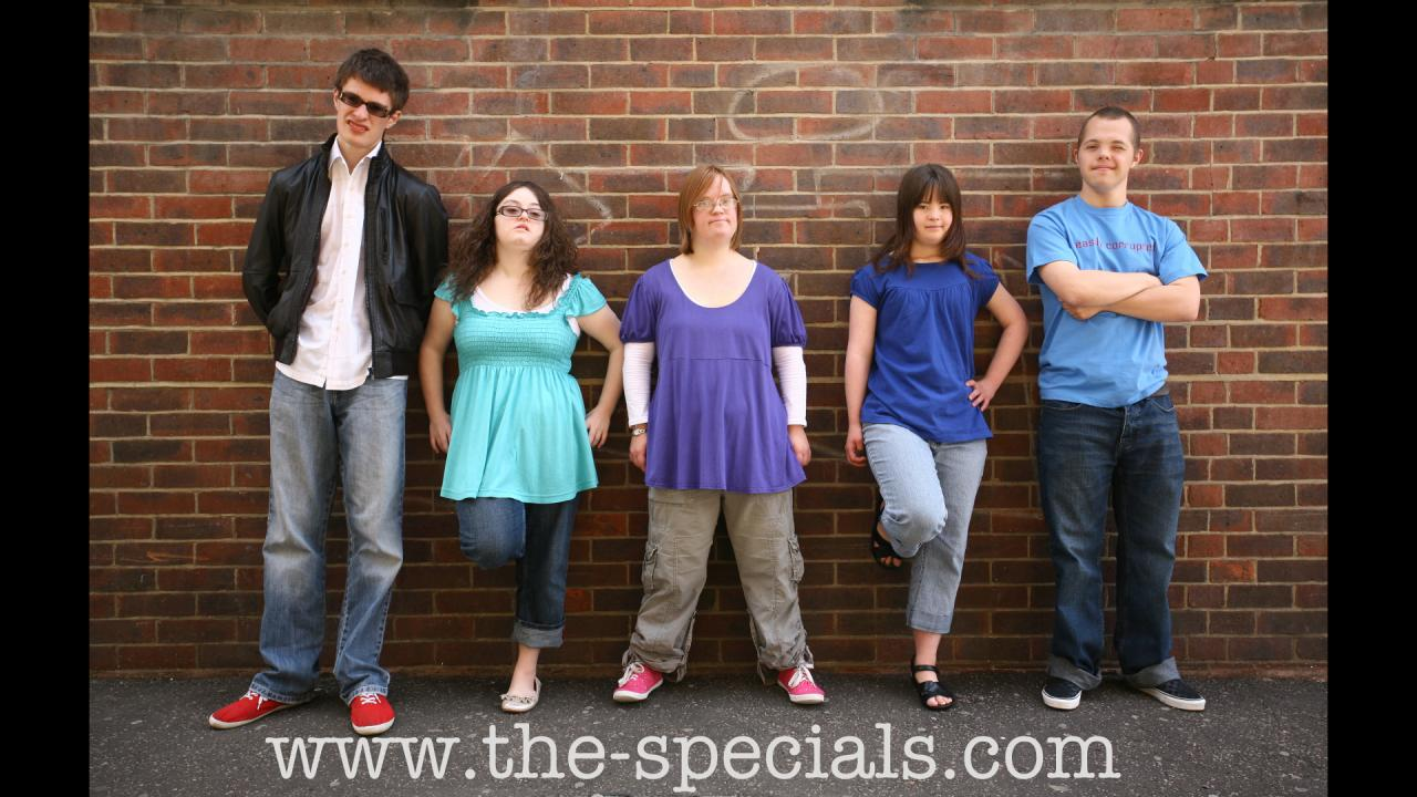 Lewis, Hilly, Lucy, Megan and Sam standing infront of a brick wall.