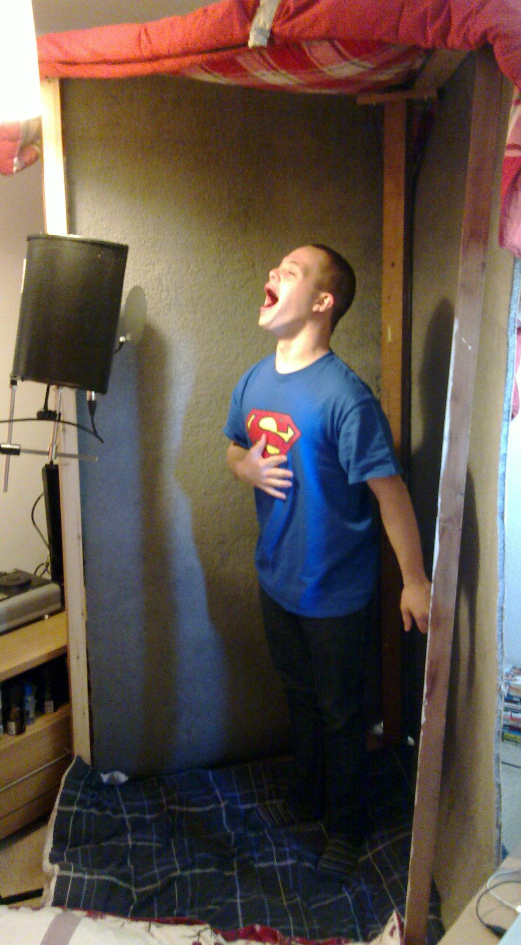 Sam in the voiceover booth in his bedroom.
