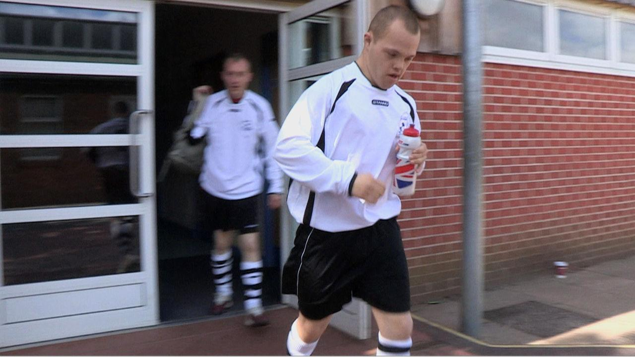 Sam running out of the changing rooms in his football kit.