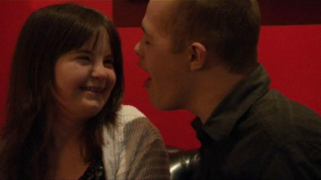 Megan and Sam flirting in a nightclub.