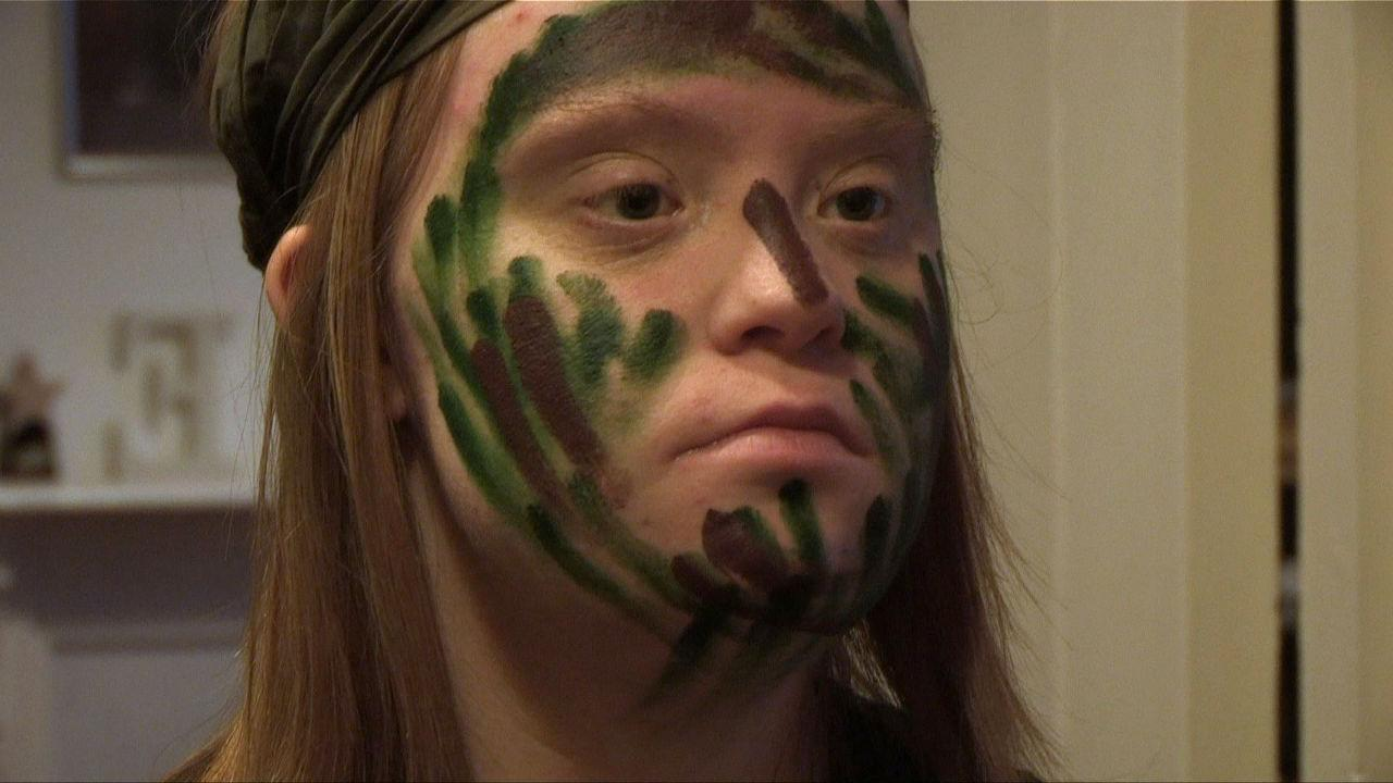 Lucy with camo-paint on her face.
