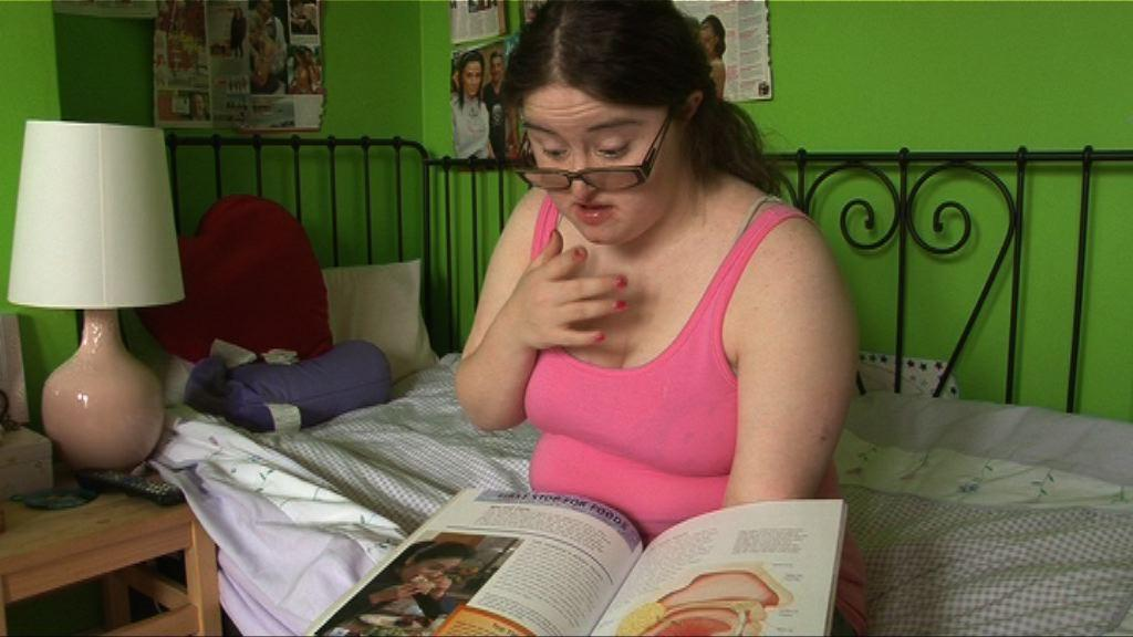 Hilly reading on her bed