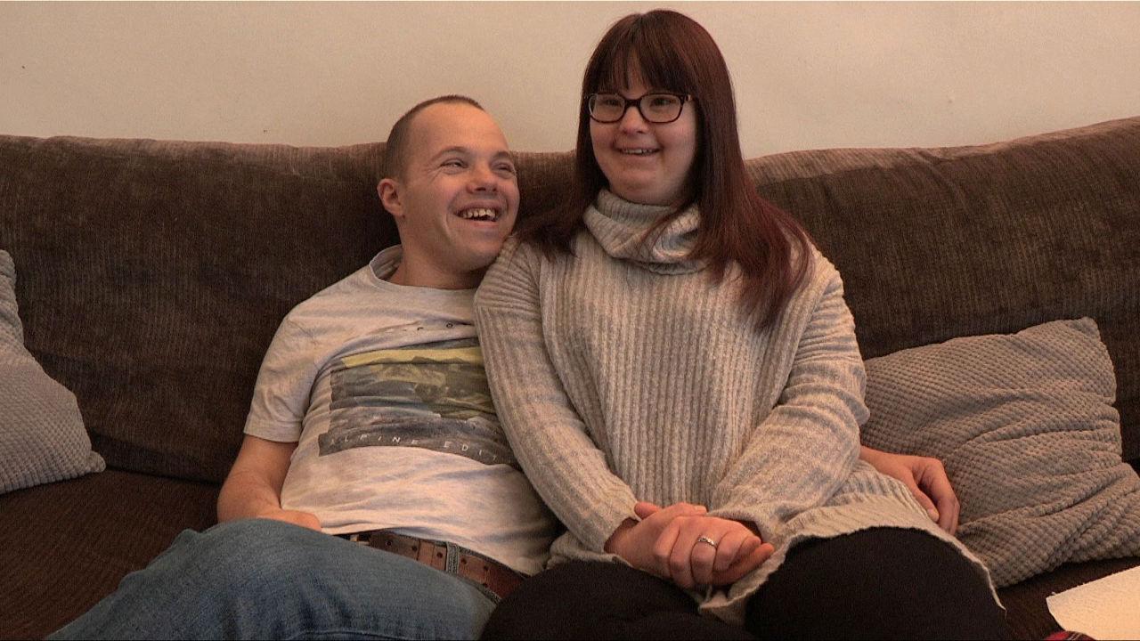 Sam & Megan on the sofa.