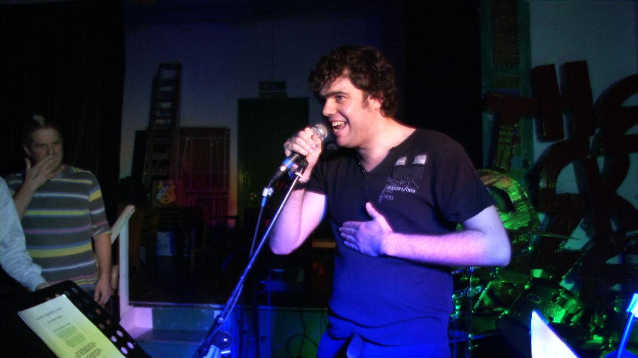 Daniel singing at the Rock House.