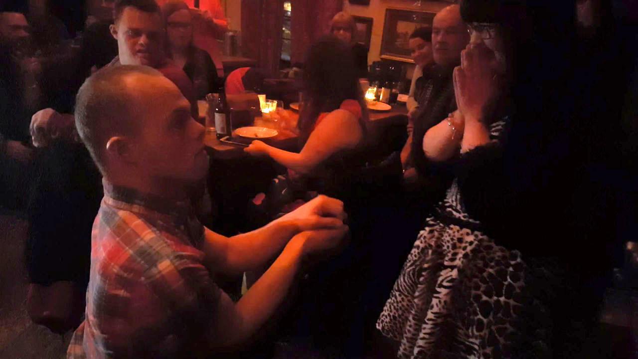 Sam proposing to Megan.